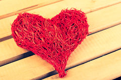 Big heart made of straw on Valentine's Day. Heart of straw on a light background of wood Stock Photography