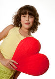 Big heart for mommy. Little girl holding a big red heart for mother's day stock photo