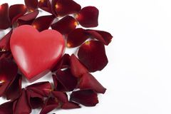 Big heart with red rose petals on white background Royalty Free Stock Photo