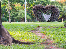 Big heart shape arbour. Selective focus of big heart shape arbour and  walk way path in the park Stock Image