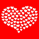 Big heart shape comprised by smaller ones  on red background. Stock Image