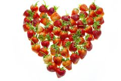 Big heart shape by strawberries stock photos