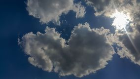 Big heart-shaped clouds, beautiful background for love themes royalty free stock photos