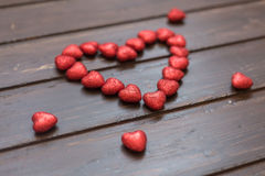 Big heart from small hearts. On a brown wooden background. Valentine's Day Stock Images