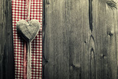 Big heart wood - on plaid fabric Stock Images
