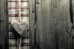 Big heart wood - on plaid fabric Royalty Free Stock Photo
