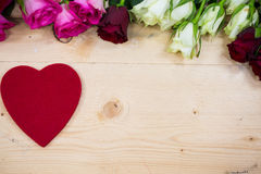 Big heart on a wooden background Royalty Free Stock Photos