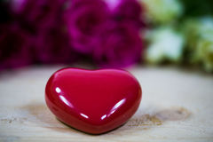 Big heart on a wooden background Royalty Free Stock Image