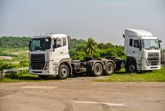 Heavy duty trucks used for delivery business. Big or heavy duty trucks used for a variety of delivery business operations Royalty Free Stock Images