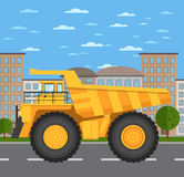 Big and heavy mining truck on road in city Stock Photos