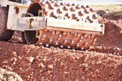Big heavy wheel of road roller. Big heavy wheel of road vibratory padfoot compactor Stock Photo