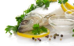 Big herring with a lemon and the spices Stock Image