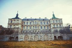 Big high contrast panorama: Podgoretsky Castle. Pidhirtsi, Ukraine, appearance of the central entrance in autumn.  Royalty Free Stock Image