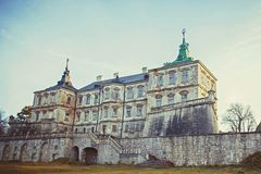 Big high contrast panorama: Podgoretsky Castle. Pidhirtsi, Ukraine, appearance of the central entrance in autumn, side view.  Royalty Free Stock Photo
