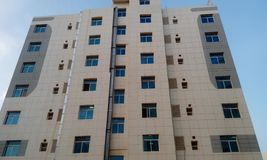 High rise building having big apartments with front elevation view. Big high rise building having apartments front elevation view painted buildings windows doors stock photography