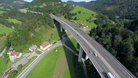 Big highway road bridge in a nature. Aerial shoot of a nice construction highway bridge in a nature and motorway road under the bridge stock video