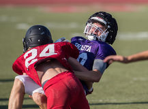 Big Hit. Football action with Shasta High School vs. Foothill in Palo Cedro, California Stock Photo