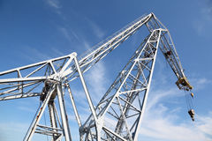 Big hoisting crane with hook Royalty Free Stock Photography