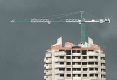 Big hoisting tower crane in stormy weather Royalty Free Stock Images