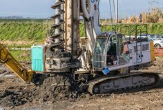 Big Hole Drilling. Large construction drill wok through the ground Stock Photography