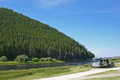 Big Hole River Camping. A luxury motorhome camped along the Big Hole River in southern Montana Royalty Free Stock Photo