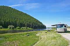 Big Hole River Luxury Camping. A luxury motorhome camped along the Big Hole River in southern Montana Stock Image