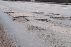Big hole in street asphalt Royalty Free Stock Photos
