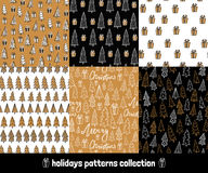 Big holiday hand drawn patterns set. Collection of winter backgrounds with gifts, christmas trees and lettering Royalty Free Stock Images