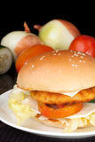 Big Homemade Cheese Chicken Burger. In black background Royalty Free Stock Images