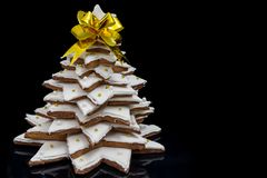 Big homemade gingerbread Christmas tree on dark background. Mockup for seasonal offers and holiday post card Stock Photo