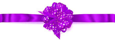 Big horizontal bow made of ribbon in polka dots. Beautiful big horizontal bow made of purple ribbon in polka dots with shadow on white background Royalty Free Stock Photography