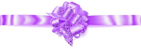 Big horizontal bow made of ribbon in polka dots. Beautiful big horizontal bow made of violet ribbon in polka dots with shadow on white background Royalty Free Stock Image