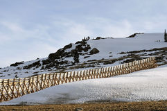 Big Horn Area, Montana. Wooden snow-drift fence runs up  hillside in the Big Horn Area, Montana Royalty Free Stock Photos