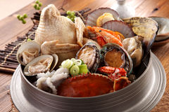 Big hot pot of Tang Emperor of the Sea with fresh octopus, abalo Royalty Free Stock Images