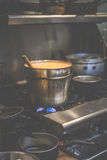 A big hot pot of  thai curry while cooking on the gas stove in thai restuarant in USA.. Stock Photos