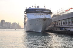 Big hotel ship is mooring at the port of Hong Kong Stock Photography