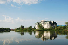 Big hotel on the water. A big hotel sitting on the edge of the water Royalty Free Stock Images