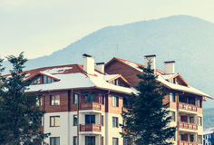 Big house with a balcony in winter. Big house with balconies on winter sky background stock photos