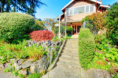 Big house with beautiful curb appeal and entrance gate Stock Images