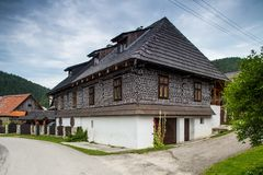 Big house with decorations in Cicmany. Cicmany, Slovakia - august 02, 2015: Old wooden houses in Slovakia village Cicmany, traditional painted with white paint Stock Photography