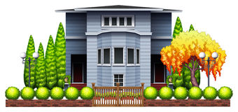 A big house with fence and plants Royalty Free Stock Photo