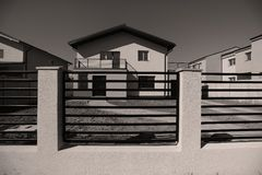 Big house with fence for sale. New house with big yard for sale, real estate agency Royalty Free Stock Photography
