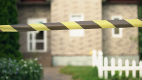 Big house fenced with black-yellow barricade tape, facade restoration, repair. Stock footage stock footage