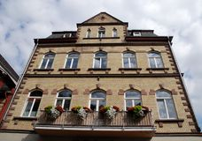 Big house with flowered balcony and large white windows in Bacharach along the Rhine Valley in Germany Stock Photography