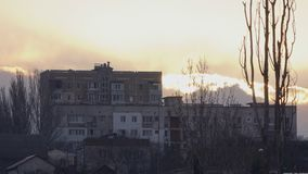 A big house on a hill during sunset.  stock video footage