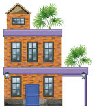 A big house with palm plants Stock Photography