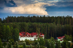 Big house with red roof in the forest Stock Photography