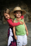 Big hug. A young girl puts her arm around her friend and gives him a hug royalty free stock photo