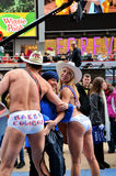 Big Hug. Between Naked Cowboy and Cowgirl having fun in Time Square on New Year's Eve Stock Photos