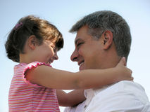 Big hug. Little girl hugging her daddy Stock Images